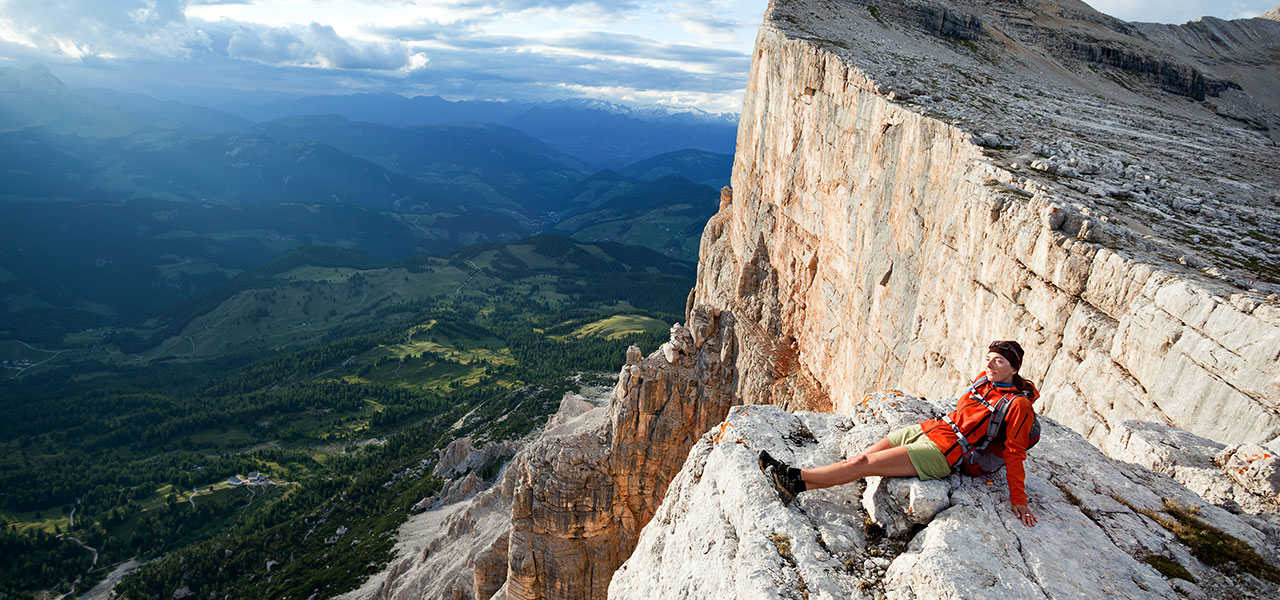 Woman enjoying the view from a Dolomite peak