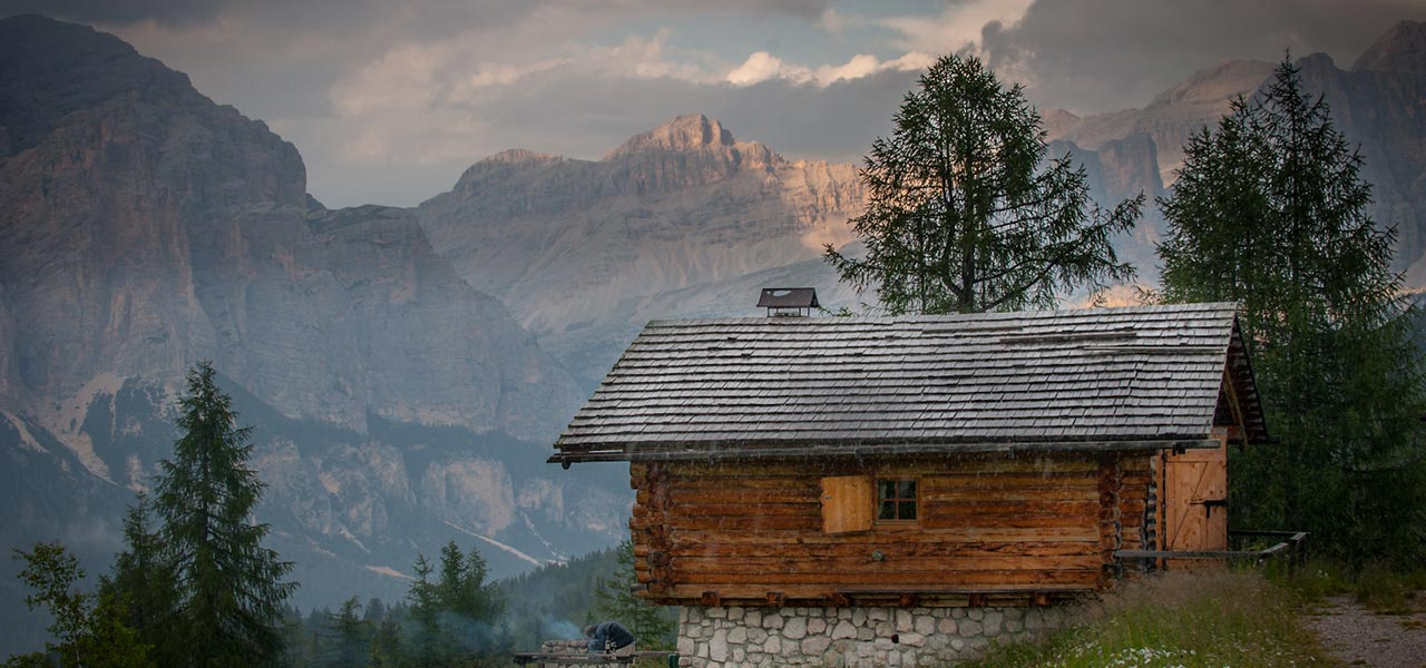 Mountain hut with woods and Dolomites