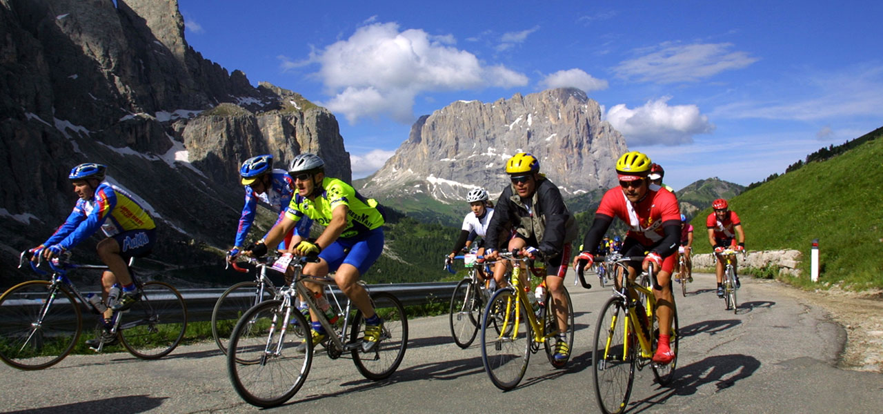 Group of cyclists on Dolomite road with mountain view
