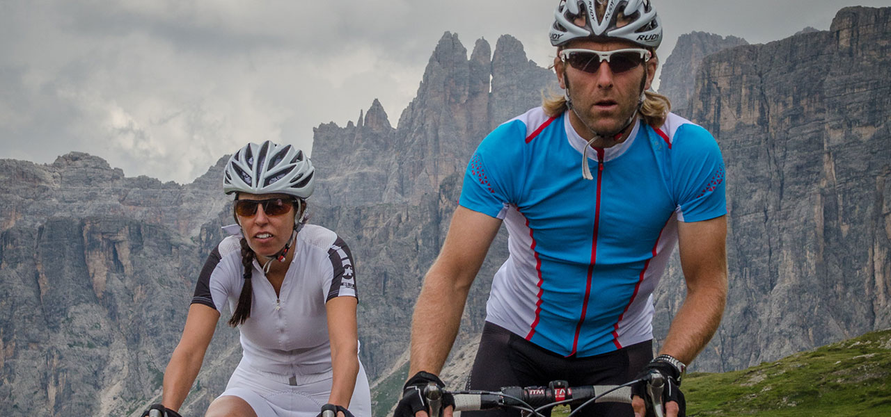 Cyclists with Dolomite wall in the background
