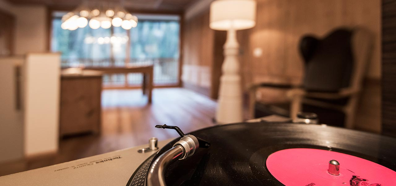 a record player with the billiard room in the background