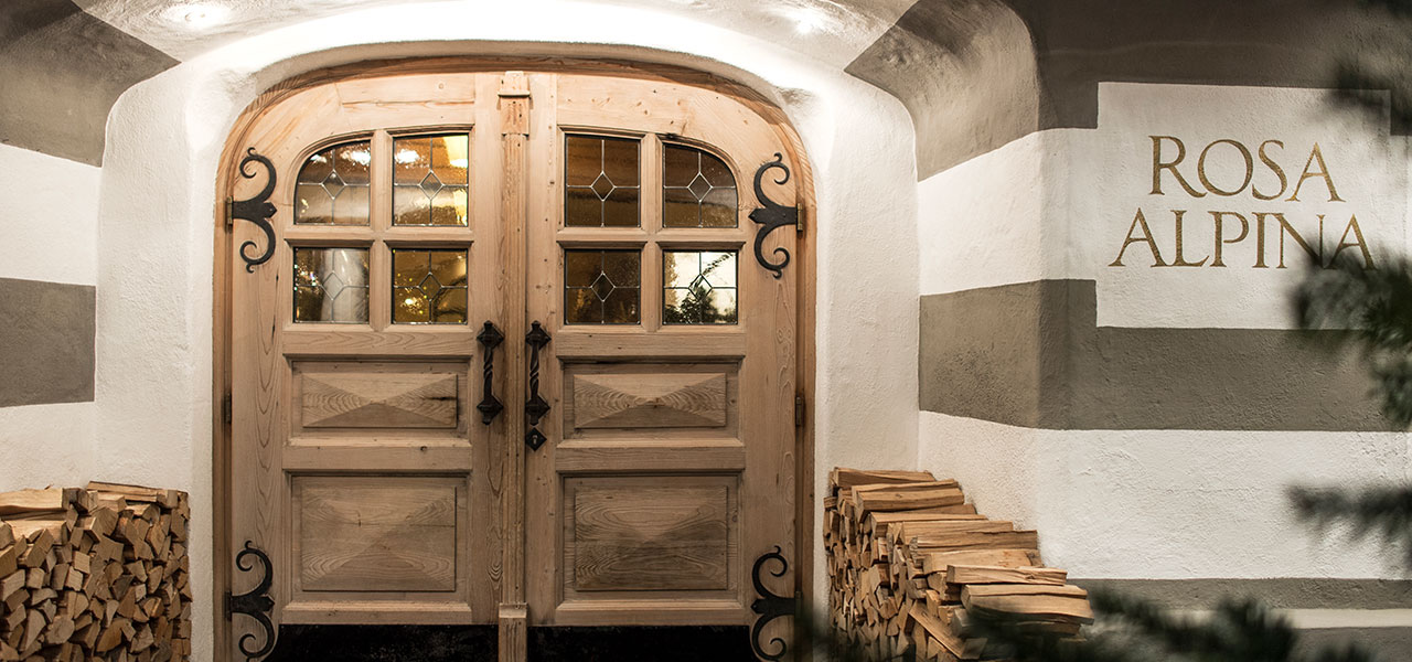 Wooden entrance door to Hotel Rosa Alpina