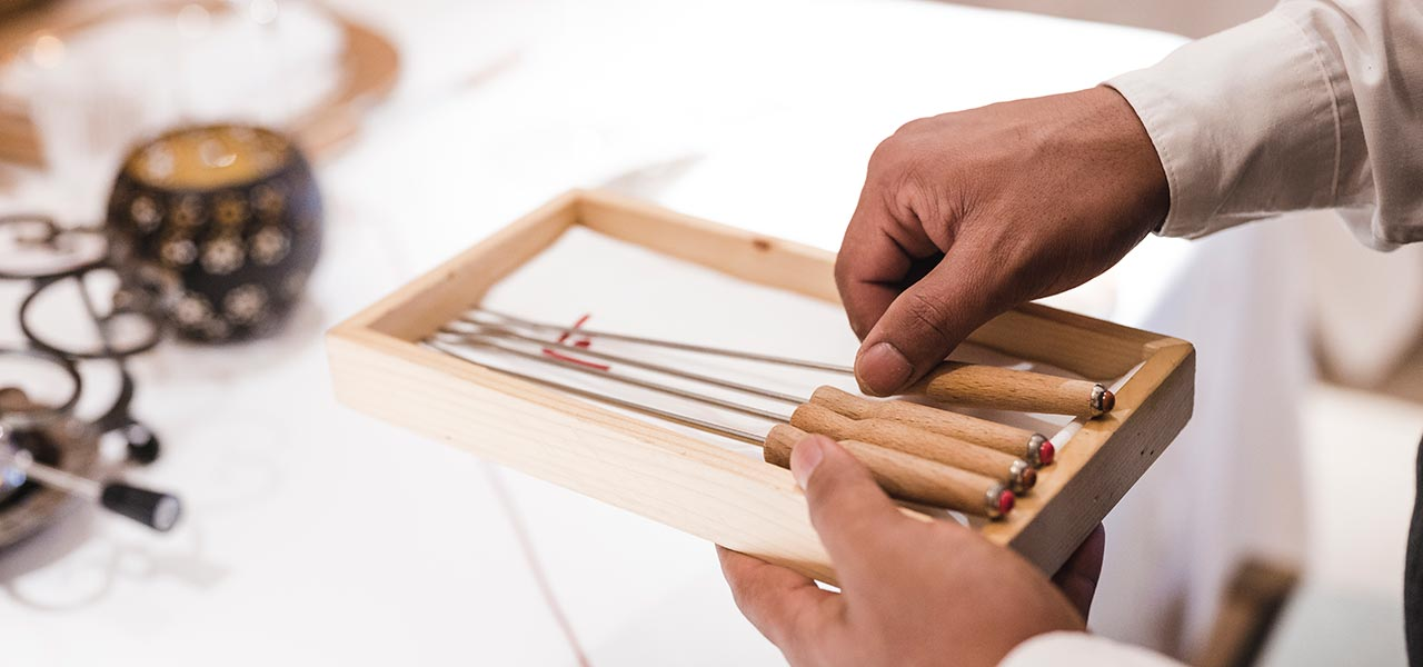 Wooden tray with fondue skewer
