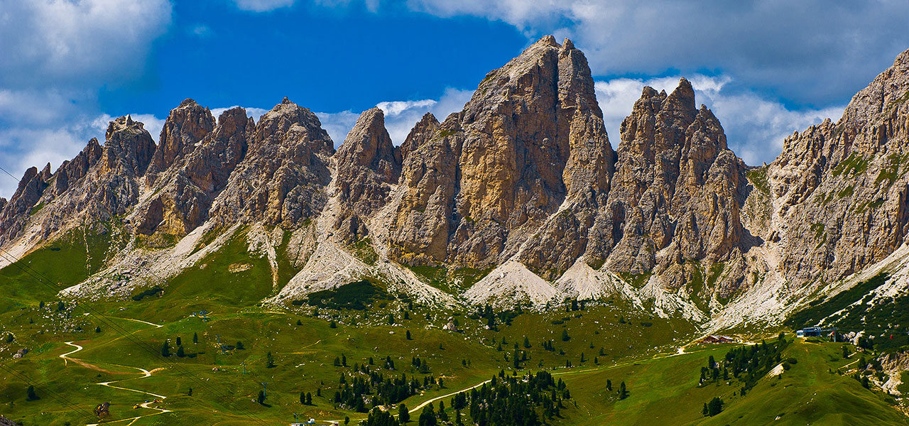 Dolomite panorama with Alpine pastures and hiking paths
