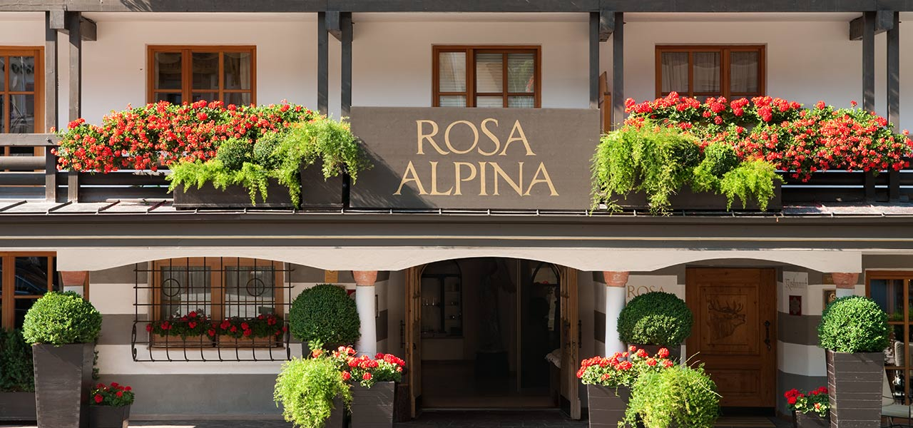 Entrance to Hotel Rosa Alpina, adorned with flowers