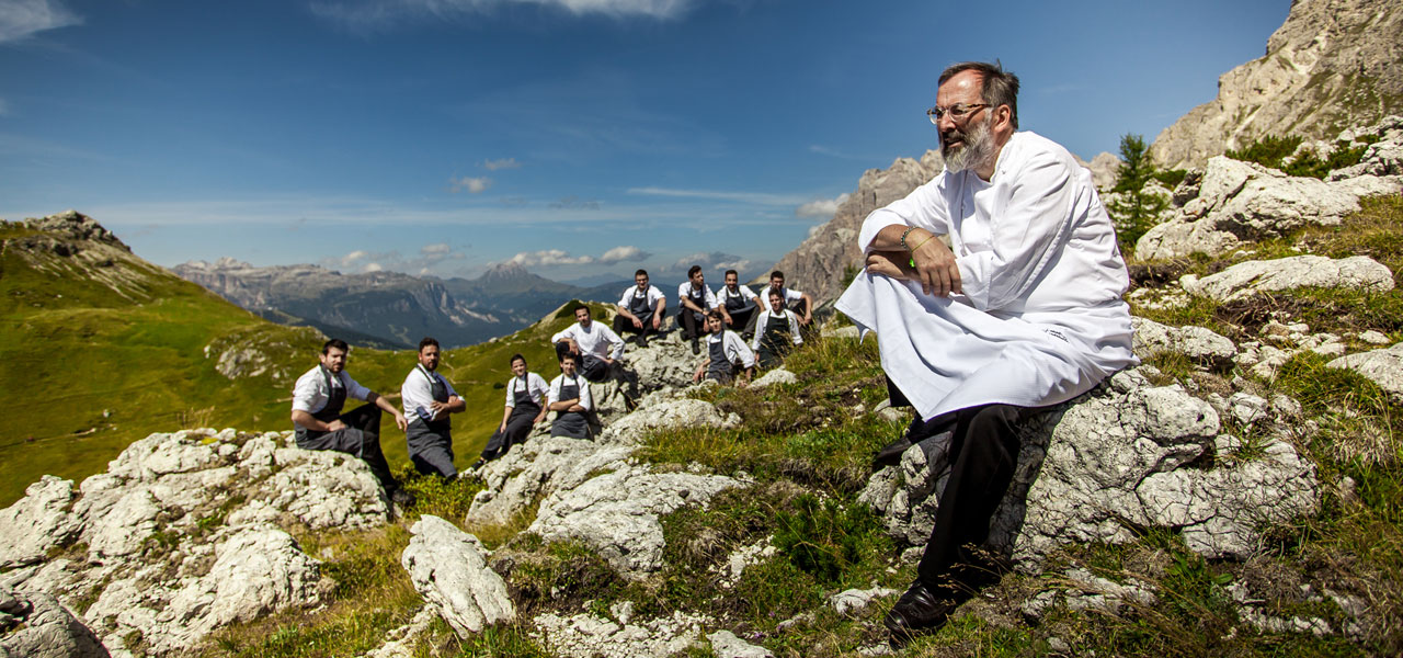 Chef Norbert Niederkofler and his kitchen team on an Alpine meadow
