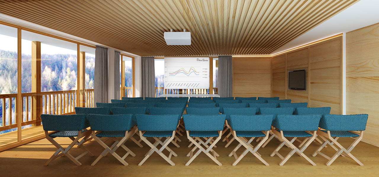 Wood paneled room with projector, flat screen, speaker table and chairs