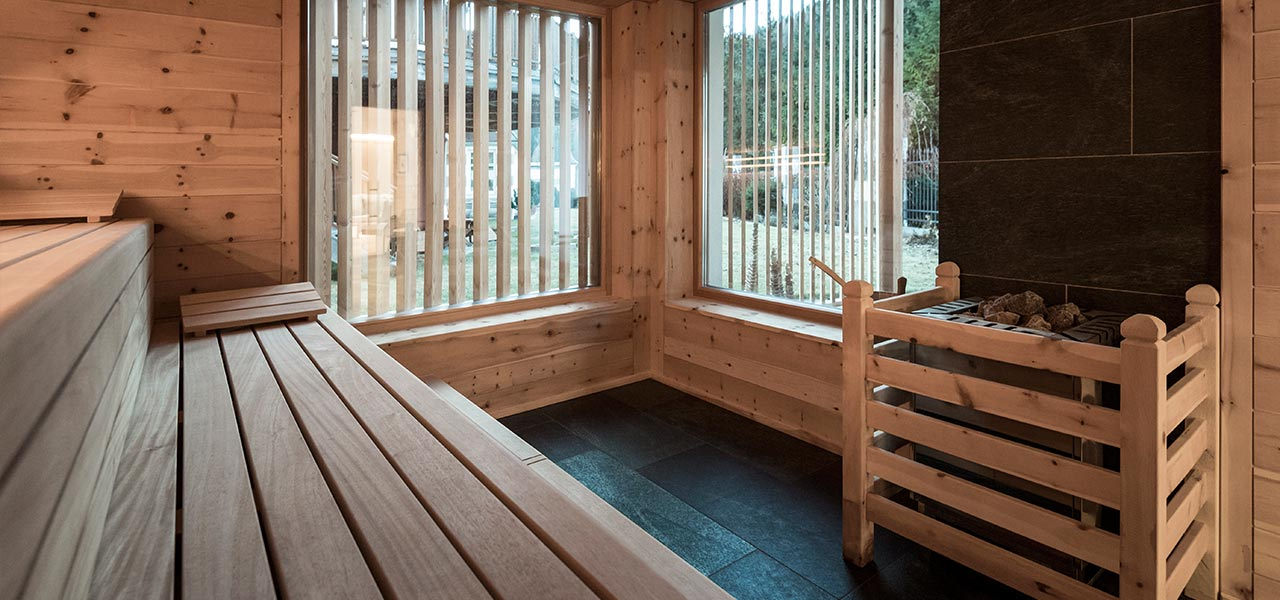 Interior of the Finnish sauna in natural wood and windows with wooden details