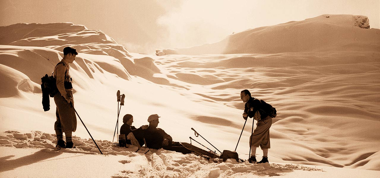 Historical sepia picture of skiers