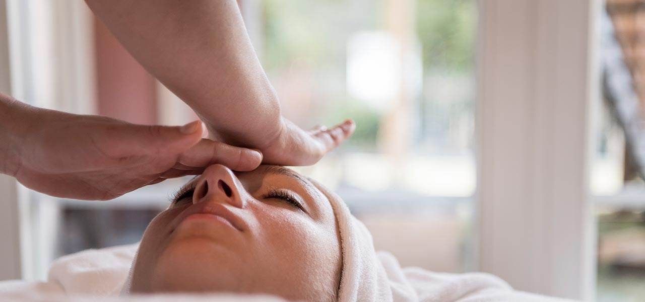 a facial massage in the wellness area