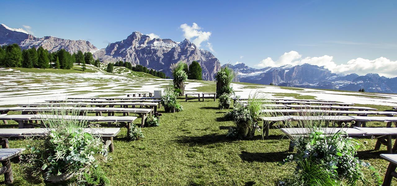 Benches and decorations for wedding ceremony with view of the Dolomites