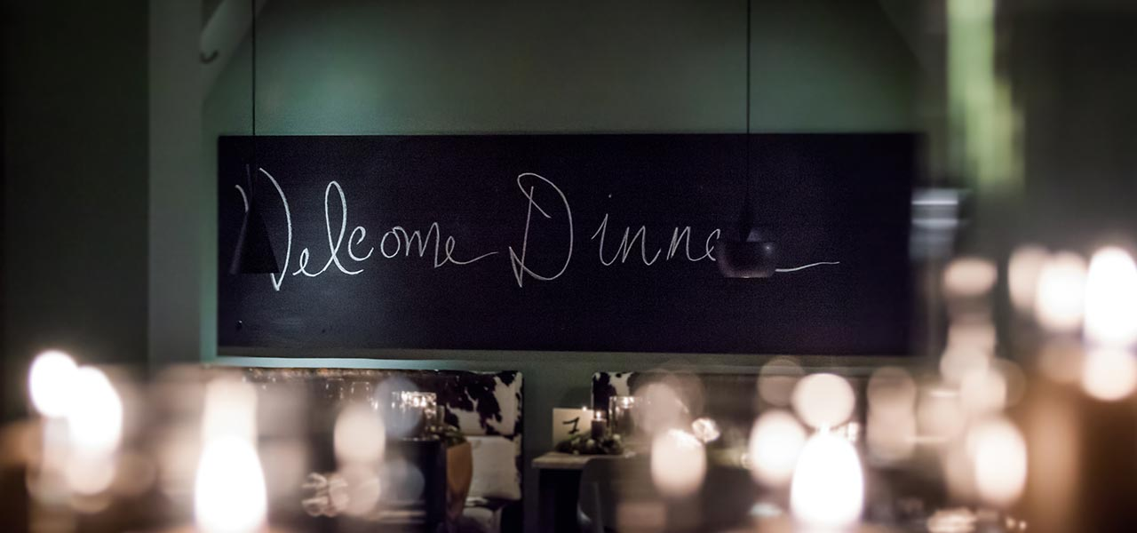 Blackboard with writing 'Welcome Dinner'