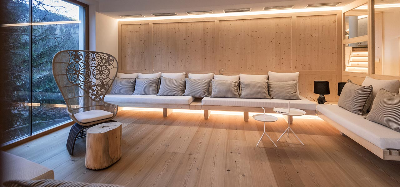 Relax area made by untreated wood in the wellness area of Rosa Alpina