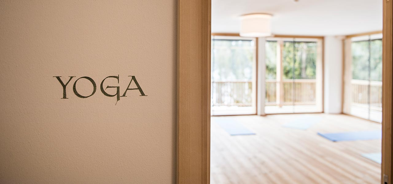 Entrance to the Yoga Studio and outer wall in the foreground with the word Yoga